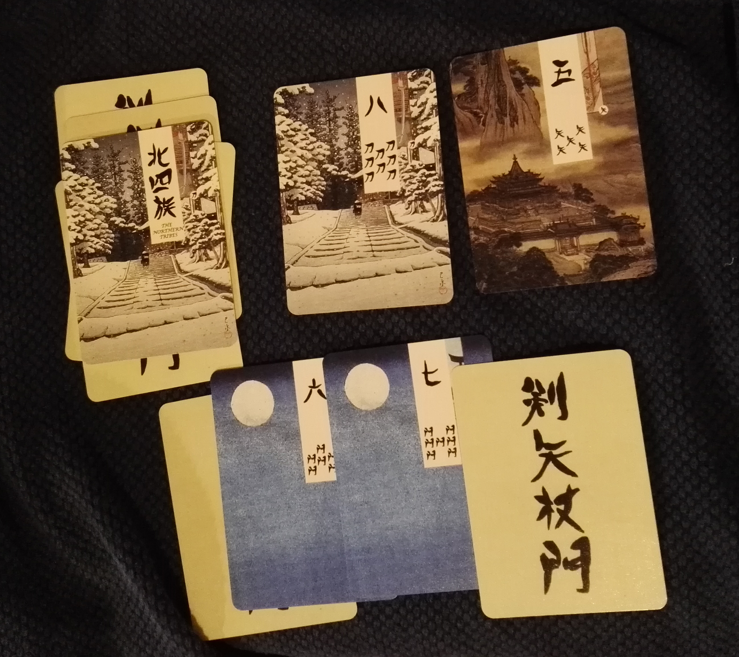 One Side of a Commanding Conquerors Game Field with a Classic, Ukiyo-e Style Age of Heroes Deck